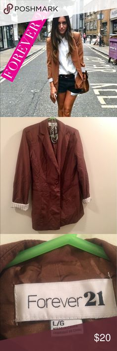 Turn up sleeve blazer 🌼Pre-owned Long turn up sleeve blazer ~ can be worn with anything - a dress , shorts , dress, pants - versatile . 🌸Brown goes with any color . 🌼Worn only twice. Add this to your closet today & you will be glad you did. Has 2 decorative pockets. 🌸Blazer is 30 inches long. Forever 21 Jackets & Coats Blazers