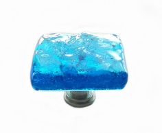 Glass knob in elegant deep turquoise art glass will make a beautiful beachy accent on bathroom or kitchen cabinets. Softly textured transparent