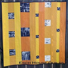 Debbie Grifka, Esch House Quilts, loves to design and make bold, graphic quilts. For her stop on the Quick Column Quilts Blog Tour, she made a version of the Floating Blocks quilt. Her fabric choice is supurb.
