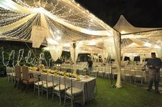 Transparent tents (strings of lights and ribbons of tulle).
