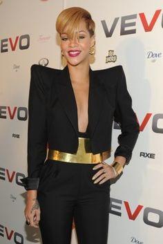 Rihanna: Black blazer with gold belt Black pants.