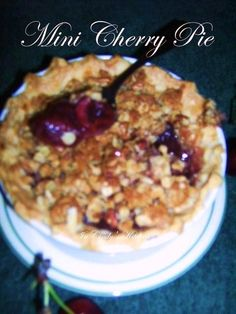 In Cindy's Kitchen: Mini Cherry Crisp Pies: Farewell Summer... a flaky buttery bottom crust, a crunchy topping, with a sweet and tart goodness in the middle.
