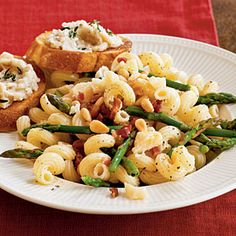 pasta with asparagus, pancetta & pine nuts ~ recipe ~ cookinglight.com ~ love this quick dinner and sometimes add rotisserie chicken