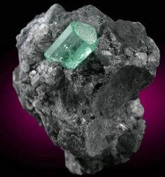Mineral Specimens: Beryl var. Emerald in Calcite from Polveros Mine, Vasquez-Yacopí District, Boyacá Department, Colombia