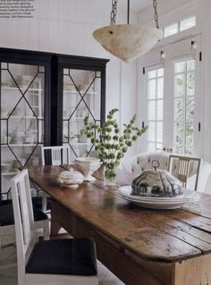 I love the old with the contemporary....wood table and white and black chairs and cabinet...