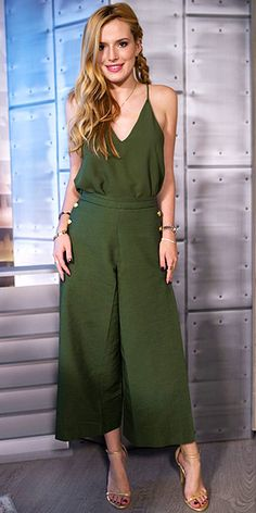 Last Night's Look: Love It or Leave It? Vote Now! | BELLA THORNE | wears an army green Camilla and Marc culottes ensemble with a long gold necklace, Stuart Weitzman heels and a sassy side braid to film The Lowdown with Diana Madison in Hollywood.