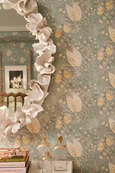 DIY Alternative: Dip ribbon or a strip of fabric (muslin? Burlap?) in plaster of paris and place around the frame arranging it as you go so it looks like this.-LaDolceVilla.blogspot.com hmmm. Interesting