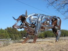 This metallic bovine creation, located in Johnson City, TX, is the work of eco-artist and sculptor Bettye Hamblen. Part of a series of sculptures by the artist, the bull is fashioned from recycled car and motorcycle parts