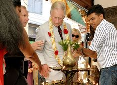 prince charles jackets catches fire at an antique shop where 65 lamps had been lit to celebrate his birthday