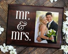 "Mr and Mrs Magnet Photo Holder FEATURES: Picture frame holds a 4"" x 6"" photo (plaque is 8"" x 10"") Photo slides in from the side and is covered by an included acrylic sheet to protect picture. Stand on"