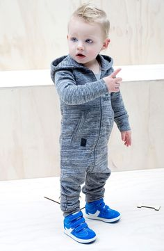 This onesie is meant for the 'brave boys' among us! The suit has a subtle mottled grey stripe print.