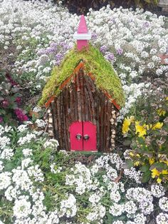A quaint fairie house that's easy to make using a birdhouse as its base.