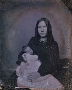 """This is my little darling,"" Ruby Ambrotype, Circa 1862    Don't worry. This is not a post-mortem. Inside the case the young mother wrote of her wee man, ""This is my little darling. May God direct him and help him to be useful through life."""