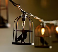 Set a spooky mood with caged crow string lights.