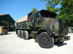 This 1994 M1070 Oshkosh Military Dump Truck Seats Six, Can Haul 60,000lbs, Has 8 Wheel Drive And Steering