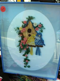 Bird at his birdhouse - Quilled this and framed it myself!!  Put it up for sale at a craft show!! - Unidentified quiller