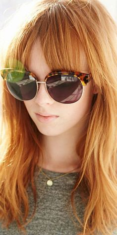 21 Awesome Hairstyles in Winter's Hottest Colors: #14. Long strawberry blonde hair with bangs