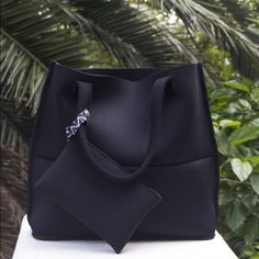 Super luxurious tote. Material is fantastic Black on black neoprene beach or yoga/gym bag with detachable pouch to hold small essentials. Fully Reversible. 100% Washable. Made in South Africa Bags