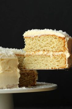 Fabulously coconutty two layered vegan coconut cake topped with a decadent coconut rum frosting. Super easy, moist, fluffy and dense at the same time (I know!) this delicious vegan cake is a total delight to the tastebuds! Vegan Coconut Cake, Coconut Flour Cakes, Vegan Lemon Cake, Coconut Rum, Coconut Frosting, Cream Frosting, Healthy Sweet Treats, Vegan Treats, Vegan Desserts