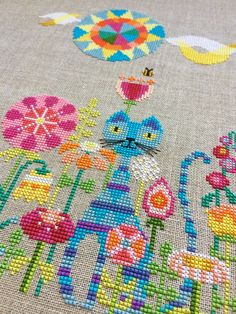 What could be more colorful and fun than this hip kitty hanging out in his fanciful spring flower garden? This cross stitch pattern is sure to
