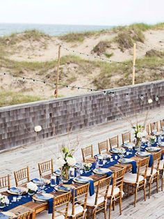 Opt for a nautical wedding color palette that compliments the blue waters, sandy shoreline and natural grasses of the beach. Long Table Decorations, Wedding Decorations, Wedding Themes, Wedding Events, Nautical Table, Nautical Home, Wedding Linens, Wedding Chairs, Seaside Wedding