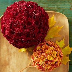 Make a statement with mums! These plush tabletop accents are easy to put together. Poke the short stems of individual mum blooms into a dampened floral foam ball until the ball is covered. Repeat with more blooms and balls. Arrange the mum-covered balls on a tray or in a bowl. Kept damp, the blooms can stay fresh for several days.
