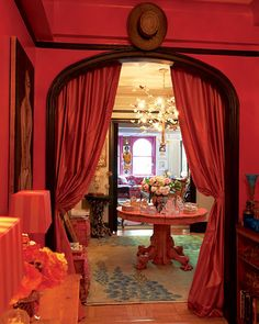 """i like red but this is a wee bit overkill. The brown breaks the color down but not enough. I love the idea of using a curtain to create an """"intimate"""" feel of the apartment"""