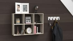 Make your entryway welcoming and stylish by hanging cube storage on the wall to display some of your favorite objects. #HomeOrganization #EntrywayDecor #HomeStorage Cubby Shelves, Cubbies, Wood Shelves, Shelving, Shelf, Smart Storage, Cube Storage, Desktop Organization, Home Organization