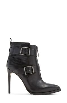Mixed-finish construction lends edgy sophistication to a tough, sensual stiletto bootie.