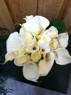 Calla lilies and roses by Weddings by Jennifer, via Flickr