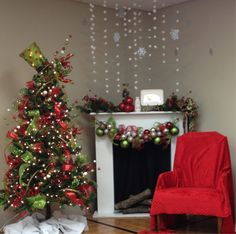 Breakfast with Santa photo backdrop-not a fan of the sheet over the chair but love the hanging decor over the fireplace