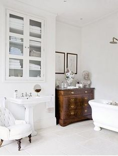 Love that chest of drawers in the bathroom for storage.