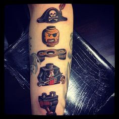 Lego pirate tattoo. u so should get this one pearl ;)