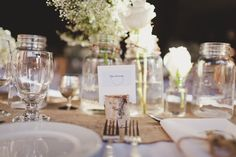rustic wedding, burlap runner, wood, greens, candles and mason jars, white flowers in jars