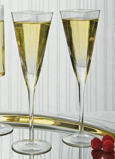 Square Toasting Flute Set includes two toasting flutes. Each flute is made of clear glass. They combine a classic and modern flute design with a thick and sturdy base, a thin stem, and a glass bowl on top in a contemporary square shape.
