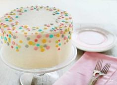 Sprinkle cake/ maybe we can make it? Purple,red, a pretty blue, and orange sprinkles?