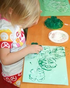 Shamrock Cookie Cutter Paint Stamping - great St. Patrick's Day activity for young kids