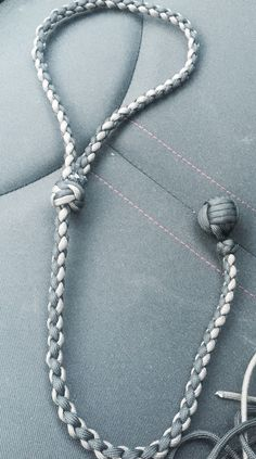 Paracord monkeyfist, self-defense, adjustable manrope knot, diamond knot, four strand round braid.