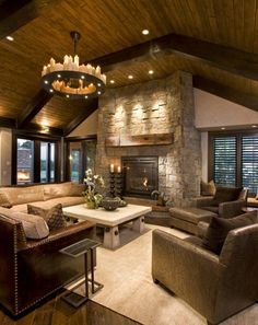 Perfect! Cathedral wood ceiling, Lots of seating, Stone fires place-Rustic Feel!!!