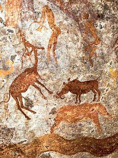 Prehistoric cave paintings Detail from a large panel of San/Bushman paintings in Mashonaland, Zimbabwe depicting antelope, warthog, elephant, snake and human figures Art Pariétal, Paleolithic Art, Art Rupestre, Cave Drawings, Africa Art, East Africa, Art Ancien, Art Premier, Aboriginal Art