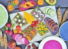 Summer weekends are for picnics in the garden! 🍓🍓 I made three different types of rainbow hummus - beet hummus 💗💗, purple potato hummus 💜💜, and zucchini hummus 💚💚. Served with toast, fresh fruits, and veggies. Recipes for beet hummus & purple sweet potato hummus can be found on my blog (link in bio). Happy weekend, all!  This is my entry for @thefeedfeed and @kitchenaidusa summer cooking contest #feedfeed #MadeWithKitchenAid