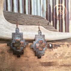 """Rustic southwest patina earrings Southwestern cut with raisedcenter Copper patina/Turquoise finish 2.75"""" from top of hook Gorgeous addition to any western jewe"""
