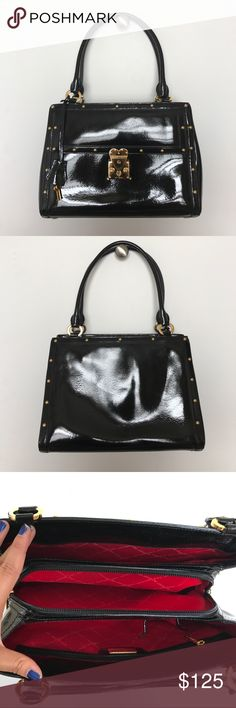 """St. John black patent leather handbag Black patent leather authentic St. John Handbag. Used but in like new condition. Gold accents with red interior. There are no scuffs, rips, or markings. Approximately 12"""" wide, 9"""" tall, and 4"""" deep. Reasonable offers will be considered. St. John Bags Shoulder Bags"""