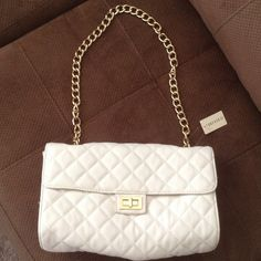 White quilted handbag New  with the tag. Never been used. Forever 21 Bags
