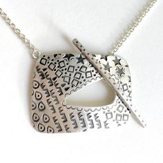 Hey, I found this really awesome Etsy listing at https://www.etsy.com/listing/486108939/stamped-toggle-clasp-pendant-in-sterling