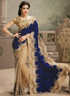 Admirable Crystal, Patch Border, Stone and Zari Net and Velvet Beige and Blue Designer Saree www.ethnicoutfits.com Product Code : (4753) Email : support@ethnicoutfits.com What's app : +918141377746 Call : +918140714515