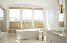 Beautiful Woven Woods add warmth to this wonderful room!