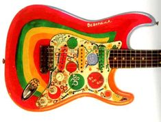 """Rocky -  George Harrison's Strat with his own artwork on the front of the guitar.  The back is still the original """"Sonic blue"""" color from the Fender Factory."""