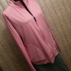 Champion zip up jacket. NWOT Pink zip up jacket.  Polyester/spandex blend.  Perfect for working out, or for a lightweight jacket.  Full zipper with front pockets. FREE GIFT WITH PURCHASE Smoke free home Always open to offers! Please use the offer button! Champion Jackets & Coats
