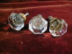 Antique drawer pull of clear glass with a brass collar. Mercury type star center.    Slightly shabby with slight edge wear / nicks, remnants or white